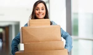Girl gets delivery package from shopping sites
